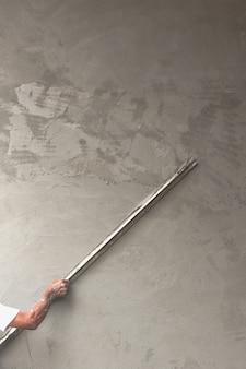 Bouwer werknemer pleisterwerk beton
