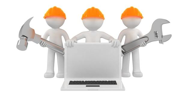Bouwers met laptop en gereedschap