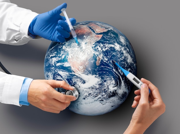 Bovenaanzicht artsen die de aarde vaccineren