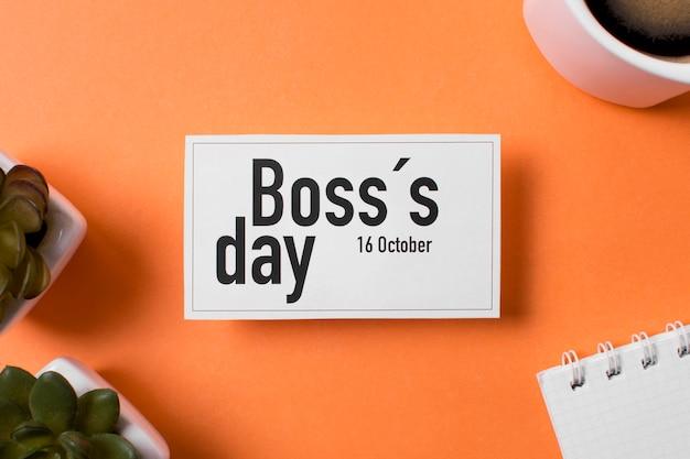 Bovenaanzicht baas dag arrangement op oranje achtergrond