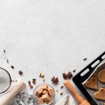 Bovenaanzicht bakkerij-ingrediënten met koekjesbakje
