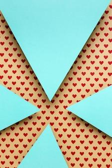 Bovenaanzicht blauwe papieren driehoeken