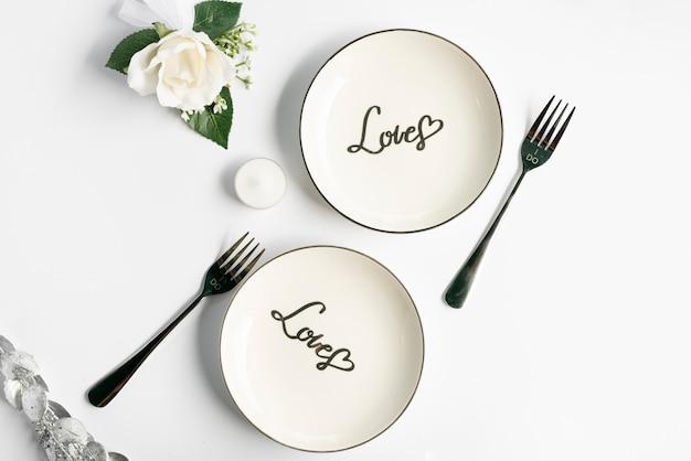 Bovenaanzicht bruiloft platen met witte achtergrond