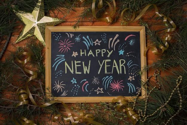 Bovenaanzicht frame met gelukkig nieuwjaar bericht
