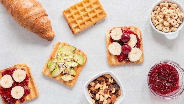 Bovenaanzicht frame van delicatesse van het ontbijt