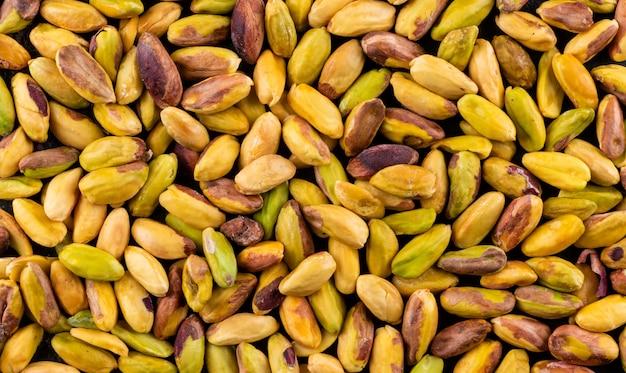 Bovenaanzicht gepelde pistaches textuur horizontaal