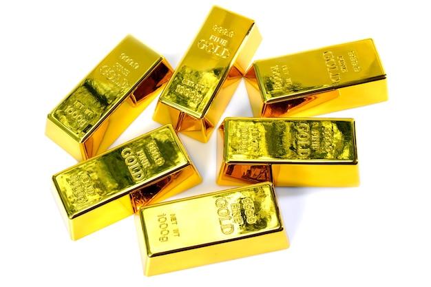 Bovenaanzicht glanzend een goudstaaf 1 kg op witte achtergrond