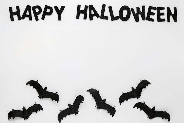 Bovenaanzicht griezelig halloween-elementen met vleermuizen