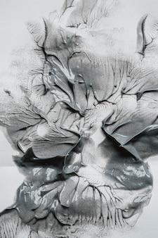 Bovenaanzicht grijs verfbehang