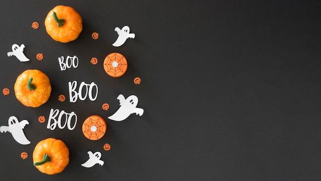 Bovenaanzicht halloween pompoenen met kopie ruimte