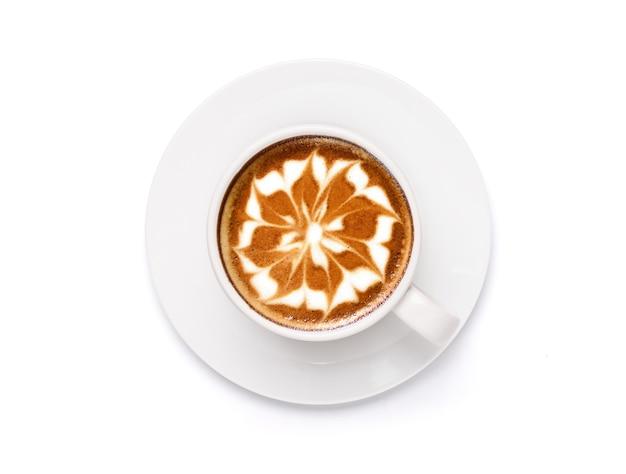 Bovenaanzicht kopje latte art koffie met bloemvorm