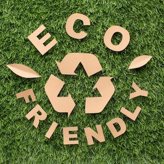 Bovenaanzicht milieuvriendelijk en recycle teken