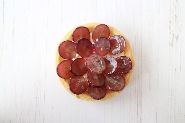 Bovenaanzicht mini druiventaart met wafel