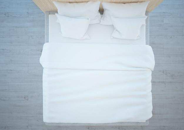 Bovenaanzicht op een kingsize bed met witte kussens