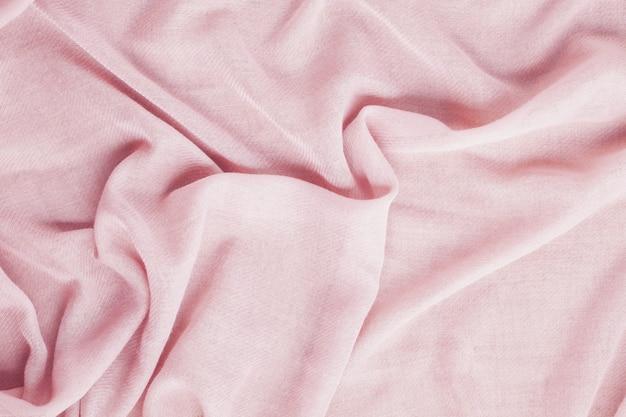 Bovenaanzicht over zachte wollen roze textieltextuur