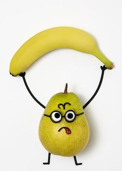 Bovenaanzicht peren- en bananenarrangement