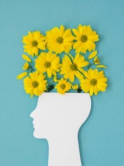 Bovenaanzicht regeling van optimisme concept met bloemen
