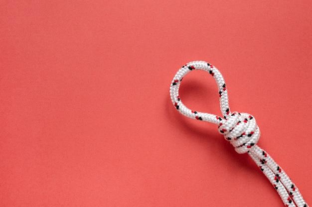 Bovenaanzicht touw met knoop kopie ruimte