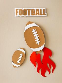 Bovenaanzicht van amerikaanse voetballen met vlam