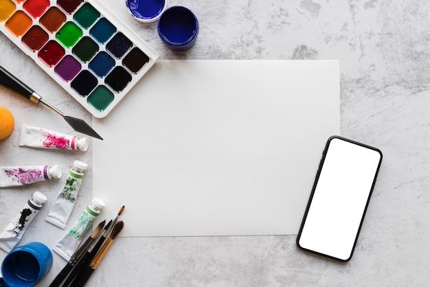 Bovenaanzicht van artist desk concept met kopie ruimte