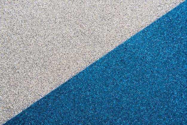 Bovenaanzicht van blauwe en grijze tapijt