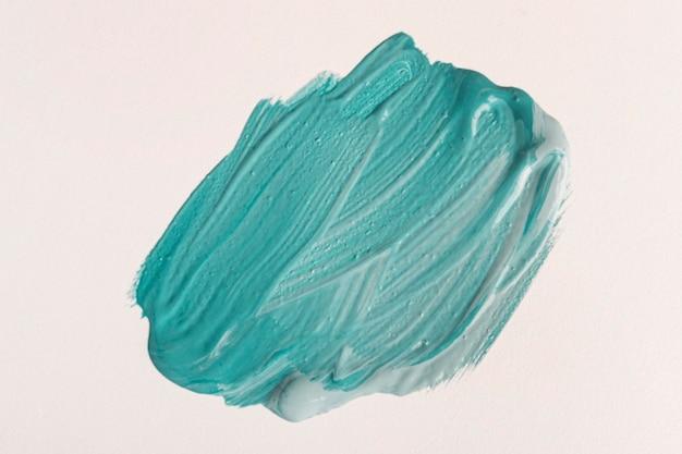 Bovenaanzicht van blauwe verf met penseelstreken
