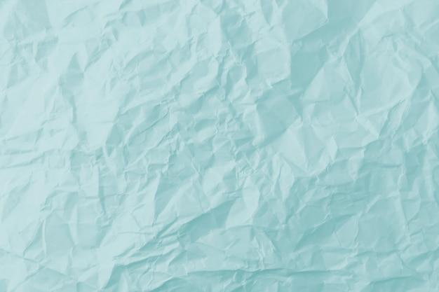 Bovenaanzicht van blauwe verfrommeld papier achtergrond.