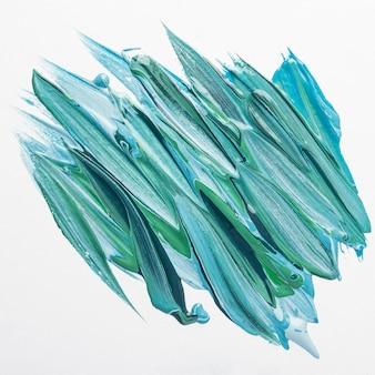 Bovenaanzicht van creatieve blauwe verf penseelstreken op het oppervlak