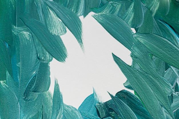 Bovenaanzicht van creatieve blauwe verf penseelstreken