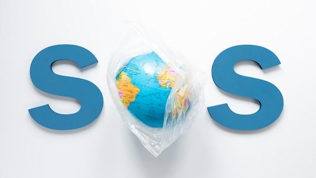 Bovenaanzicht van de wereld met sos