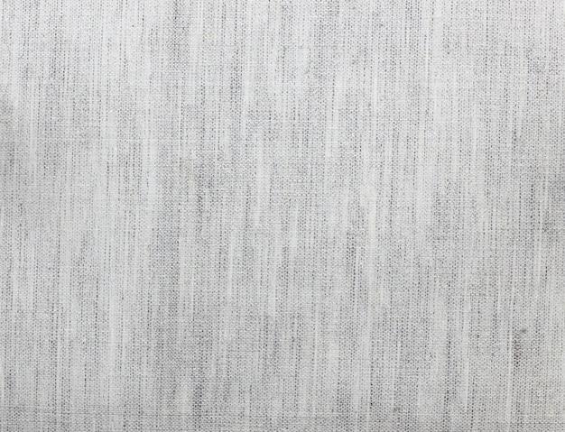 Bovenaanzicht van donkergrijze ruwe stof textuur achtergrond
