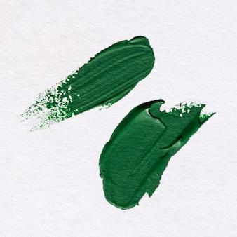 Bovenaanzicht van groene verf penseelstreken
