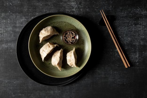 Bovenaanzicht van heerlijke dumplings concept Gratis Foto