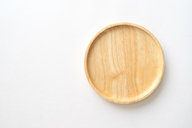 Bovenaanzicht van houten schotel voor keuken achtergrond. close-up beeld.