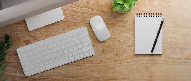 Bovenaanzicht van houten tafel met lege notebook en computerapparaat 3d-rendering
