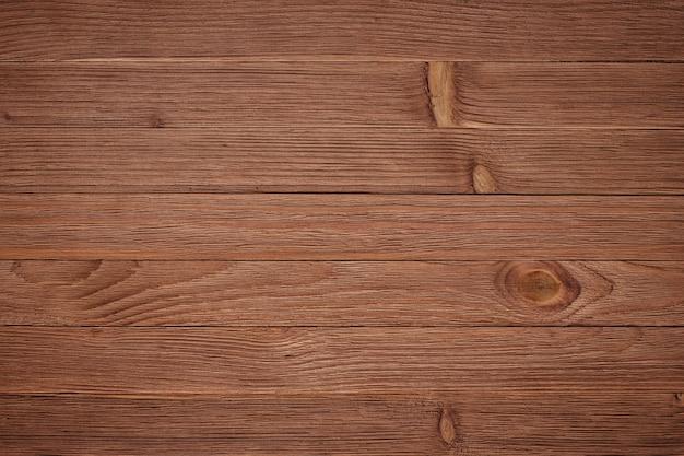 Bovenaanzicht van houten tafel, muur textuur
