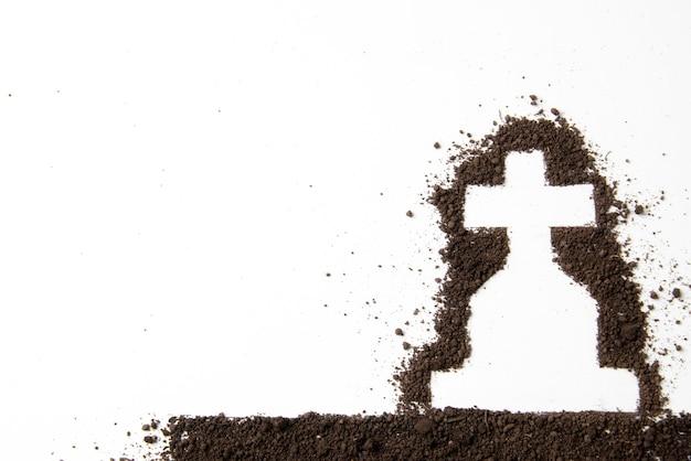 Bovenaanzicht van kruisvorm met donkere grond