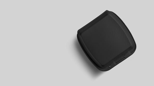 Bovenaanzicht van lege zwarte piepschuim geïsoleerd op grijs. eco-voedsel lunchconcept.