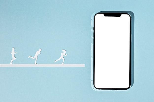 Bovenaanzicht van papieren atleten met smartphone