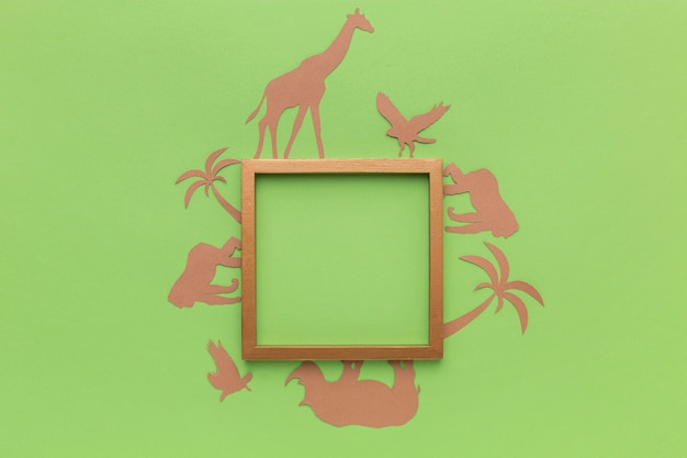 Bovenaanzicht van papieren dieren met frame voor dierendag