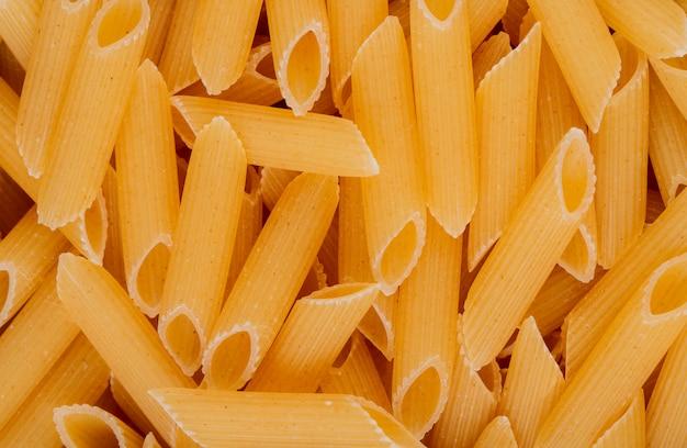 Bovenaanzicht van penne pasta achtergrond