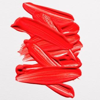 Bovenaanzicht van rode verf penseelstreken op het oppervlak