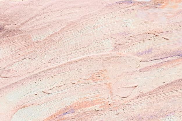 Bovenaanzicht van roze verf penseelstreken op het oppervlak