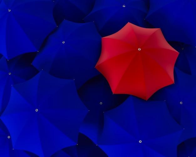 Bovenaanzicht van unieke rode paraplu die uit de blauwe menigte duidelijk uitkomt
