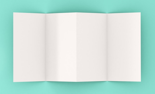 Bovenaanzicht van vier pagina's folder op blauwe ondergrond Premium Foto
