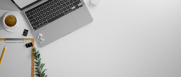 Bovenaanzicht van werkruimte met laptop briefpapier en kopieer ruimte op witte tafel 3d rendering 3d illustratie