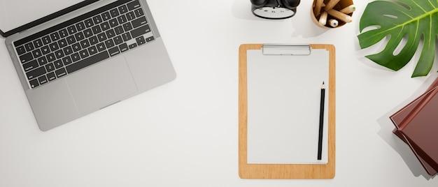 Bovenaanzicht van werkruimte met laptop klembord briefpapier en decoraties 3d-rendering 3d illustratie