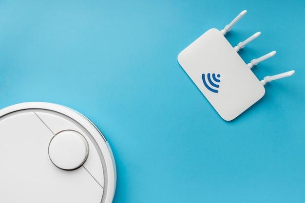 Bovenaanzicht van wifi-router met stofzuiger