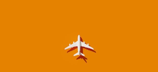 Bovenaanzicht van wit vliegtuig en oranje achtergrond