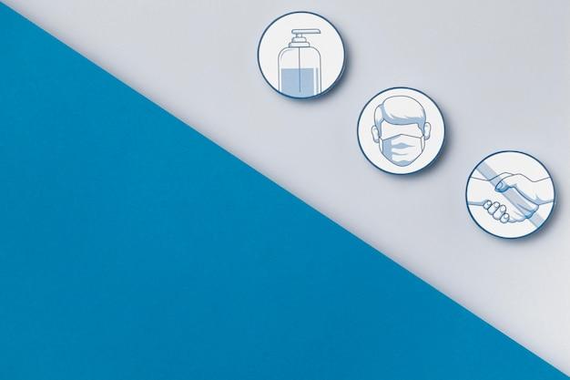 Bovenaanzicht veiligheidsmaatregelen logo's met kopie ruimte
